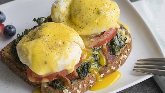 Spinach, Bacon & Tomato Eggs Benedict Recipe Image